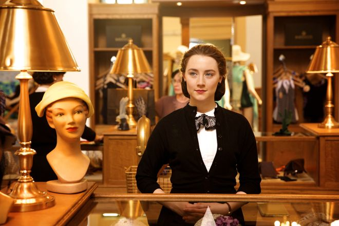 """This photo provided by Fox Searchlight shows, Saoirse Ronan as Eilis in a scene from the film, """"Brooklyn.""""  The movie opens in U.S. theaters on Nov. 4, 2015. (Kerry Brown/Fox Searchlight via AP) ORG XMIT: CAET680"""