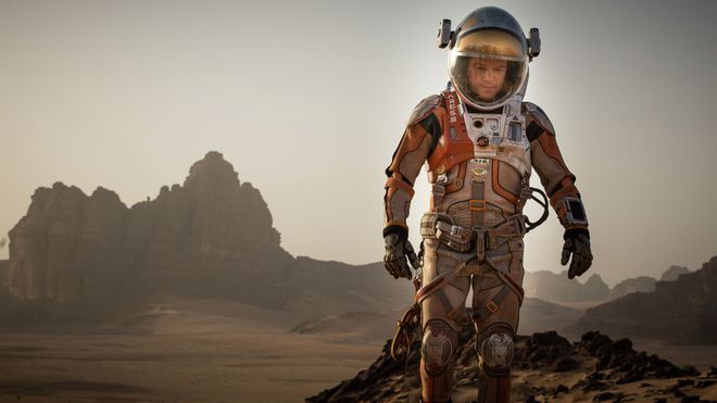 """This photo provided by courtesy of the Toronto International Film Festival and Twentieth Century Fox shows Matt Damon as Mark Watney a scene from the film, """"The Martian,"""" directed by Ridley Scott. As the largest launching pad to the fall movie season, the Toronto Film Festival which kicks off on Thursday, Sept. 10, 2015, is a regular home to the biopics and other true-life tales that usually populate awards season. ìThe Martian,î starring Damon as an astronaut left for dead on Mars, gives Toronto its strongest dose of sci-fi spectacle.  (Aidan Monaghan/Toronto International Film Festival/Twentieth Century Fox via AP) ORG XMIT: CAET214"""