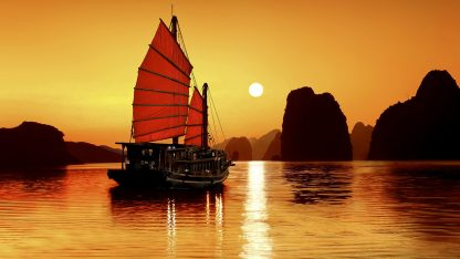 Ha-Long, Vietnam --- Junk in the sea of Halong Bay, a UNESCO World Natural Heritage Site, Karst mountains, romantic sunset, image composition, Vietnam, Asia --- Image by © Gerhard Zwerger-Schoner/imagebroker/Corbis